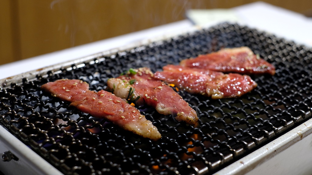 Grilling beef at Sora.