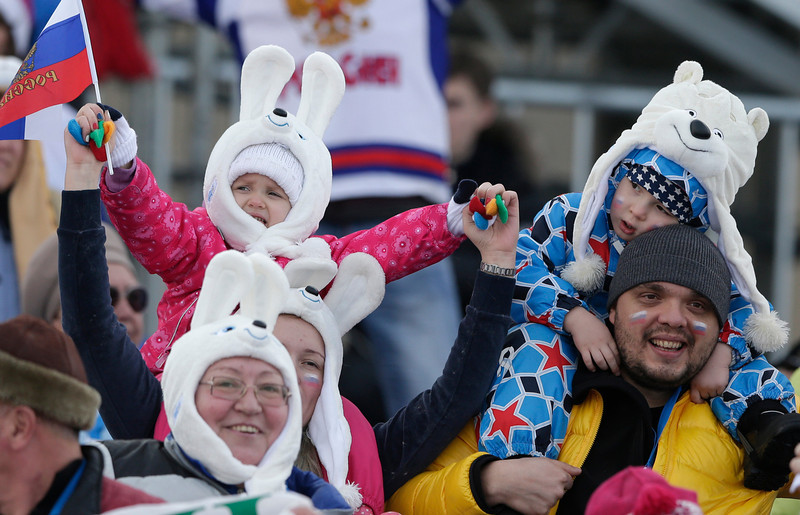 . Children watch the cross-country team sprint competitions at the 2014 Winter Olympics, Wednesday, Feb. 19, 2014, in Krasnaya Polyana, Russia. (AP Photo/Matthias Schrader)