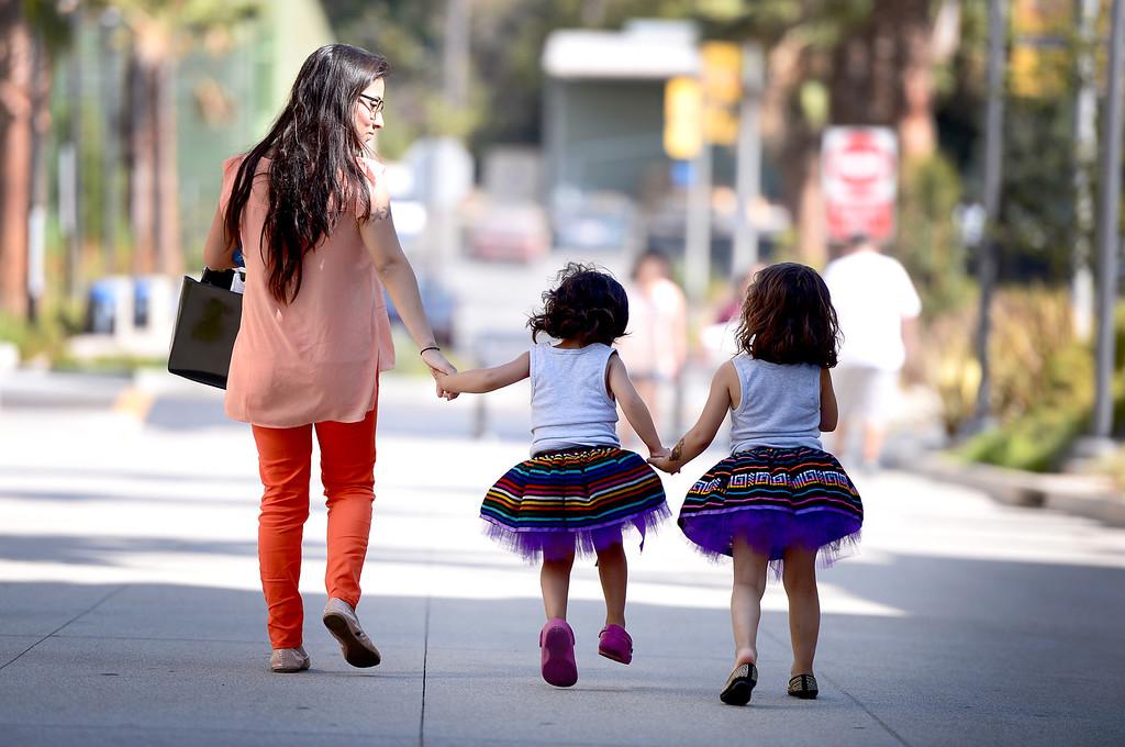 . Mayra Sosa, of Whittier, and her children Alicia 4, and Valentina, 3, leave Rio Hondo College\'s Latino Heritage Month\'s kickoff celebration Saturday, September 14, 2013. (Photo by Sarah Reingewirtz/Pasadena Star-News)