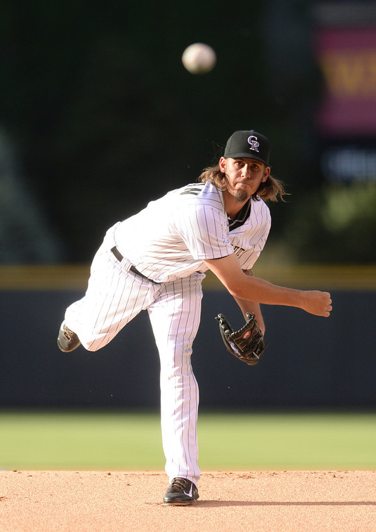 . DENVER, CO - JUNE 20: Rockies starting pitcher Christian Bergman delivered to the plate in the first inning. The Colorado Rockies hosted the Milwaukee Brewers at Coors Field Friday night, June 20, 2014. Photo by Karl Gehring/The Denver Post