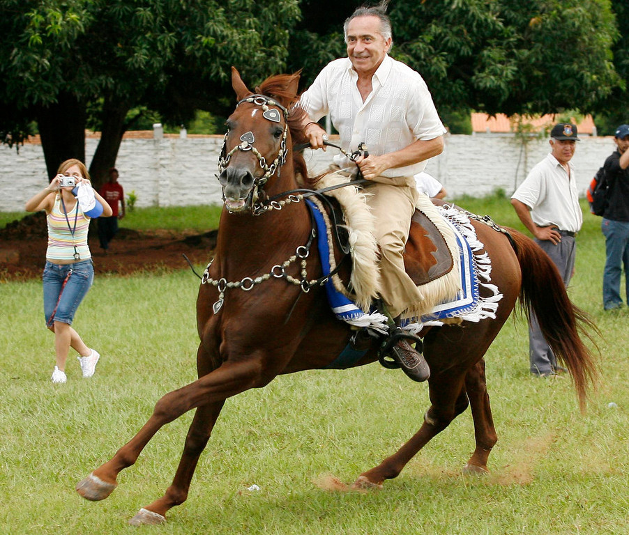 . Lino Oviedo, Paraguayan presidential candidate for the UNASE party, rides a horse during a campaign rally in the city of Yaguaron on February 24, 2008. Oviedo, who led a 1989 coup that overthrew dictator Alfredo Stroessner, died in a helicopter crash over the weekend. Police rescuers found his body on February 3, 2013 in the wreckage of a helicopter crash in northern Paraguay where he was traveling for a campaign event. He was 69. REUTERS/Jorge Adorno/Files