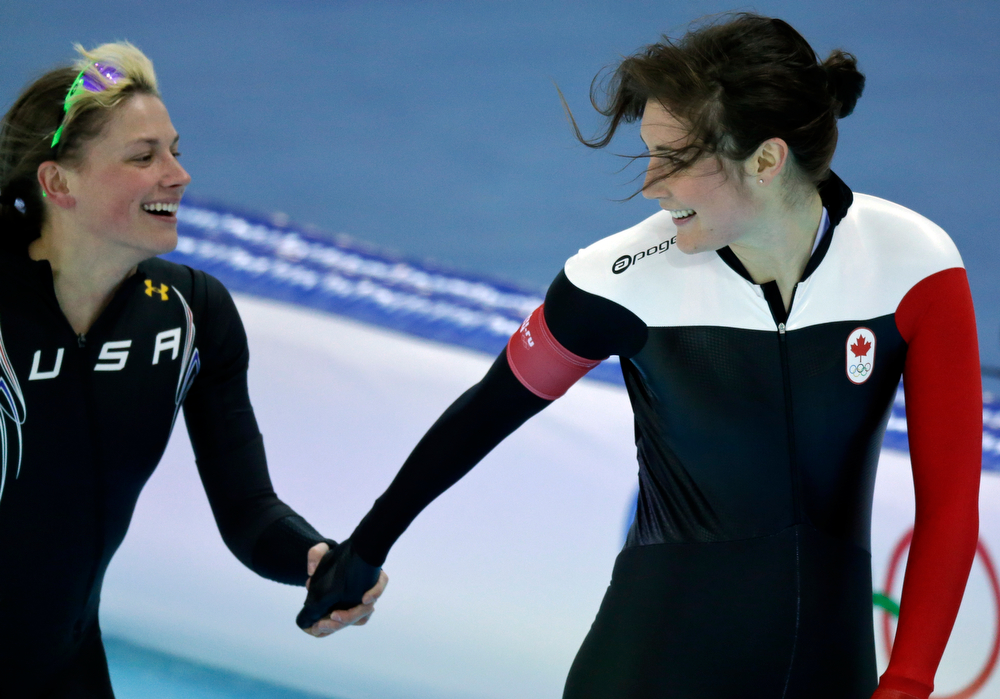 . Sugar Todd of the U.S., left, and Canada\'s Anastasia Bucsis greet after their second heat race for the women\'s 500-meter speed skating at the Adler Arena Skating Center during the 2014 Winter Olympics, Tuesday, Feb. 11, 2014, in Sochi, Russia. (AP Photo/David J. Phillip )