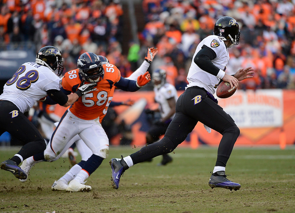 Description of . Baltimore Ravens quarterback Joe Flacco (5) scrambles from the pocket in the second quarter. The Denver Broncos vs Baltimore Ravens AFC Divisional playoff game at Sports Authority Field Saturday January 12, 2013. (Photo by Joe Amon,/The Denver Post)