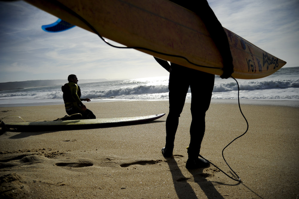 Description of . Hawaiian surfer Garrett McNamara looks at the ocean before his surf session at Praia do Norte in Nazare on January 29, 2013. McNamara arrived on January 28 at Praia do Norte, the