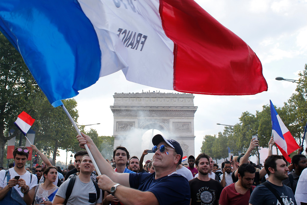 . People celebrate on the Champs Elysees avenue with the Arc de Triomphe on background after France defeated Croatia in the final match at the 2018 soccer World Cup, in Paris, France, Sunday, July 15, 2018. France won the final 4-2. (AP Photo/Thibault Camus)