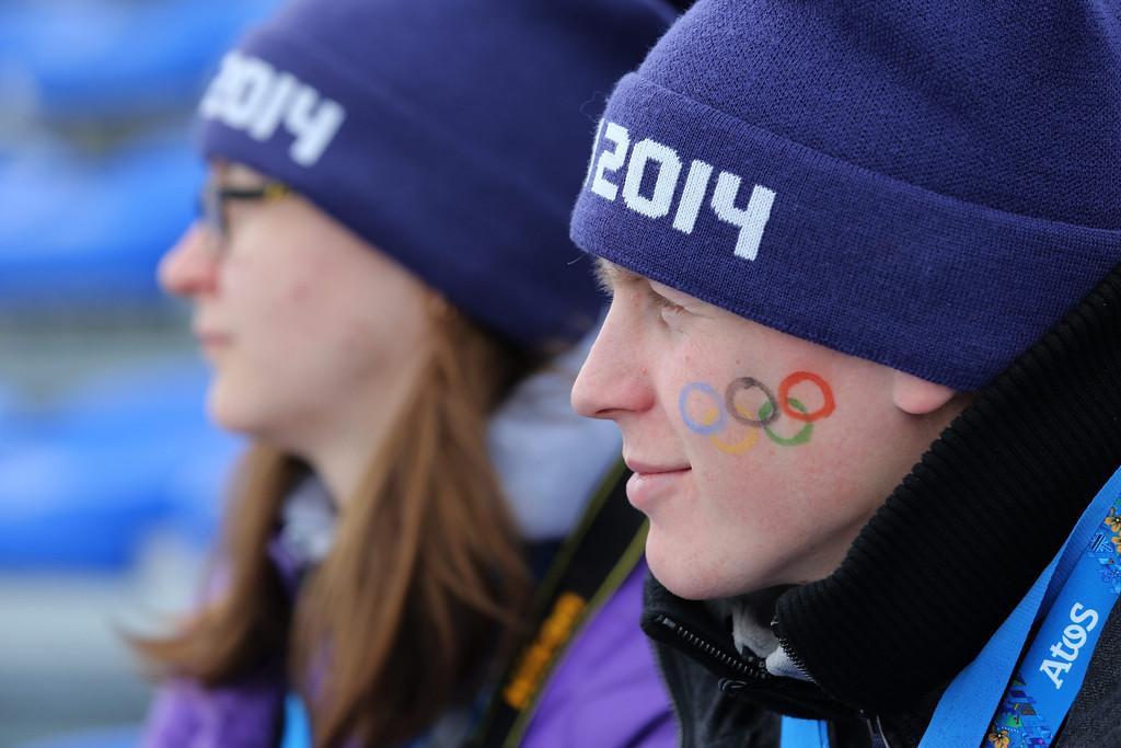 . Spectators watch the Men\'s 15 km + 15 km Skiathlon in Laura Cross-country Ski & Biathlon Center at the Sochi 2014 Olympic Games, Krasnaya Polyana, Russia, 09 February 2014.  EPA/ARMANDO BABANI
