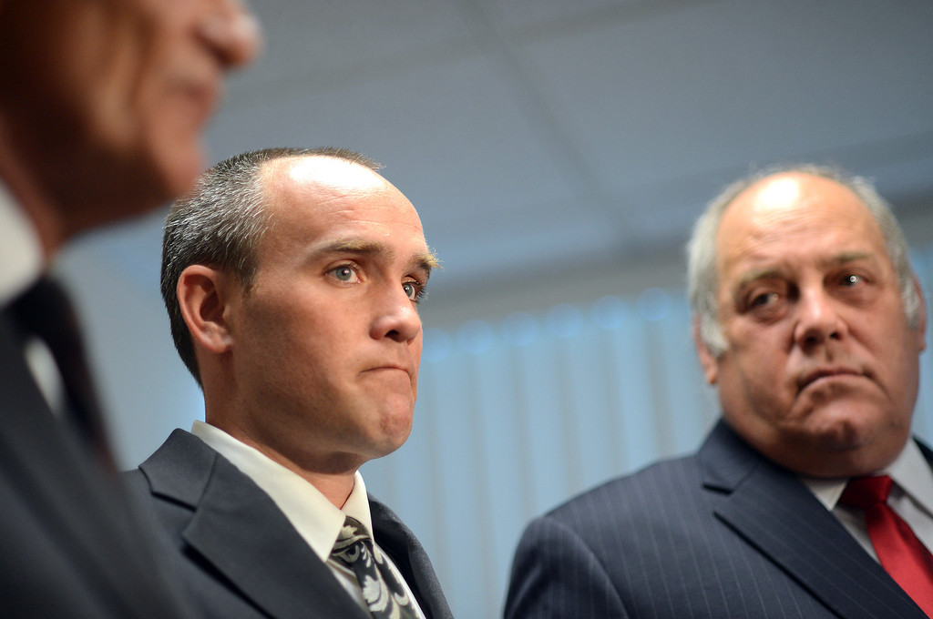 . David Perdue looks on as his attorneys Robert Sheahen and Mark Daniel Melnick (l-r) speak during a news conference in Sherman Oaks July 8, 2013.   The City of Torrance has denied that it has any liability to Mr. Perdue after shooting at him and ramming his truck during the Christopher Dorner manhunt.(Andy Holzman/Los Angeles Daily News)