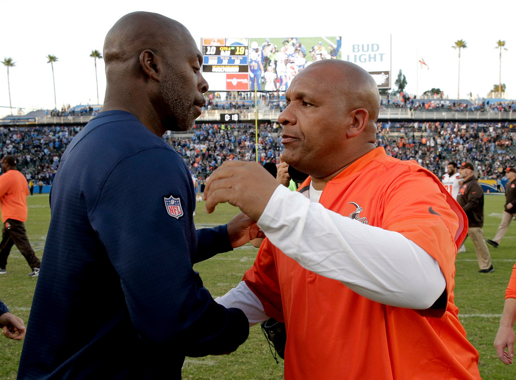 . Los Angeles Chargers head coach Anthony Lynns, left, greets Cleveland Browns head coach Hue Jackson after their win during an NFL football game Sunday, Dec. 3, 2017, in Carson, Calif. (AP Photo/Jae C. Hong)
