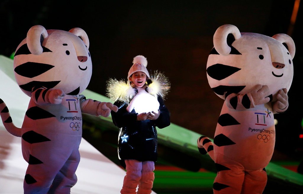 . Olympic mascots and a young girl participate in the closing ceremony of the 2018 Winter Olympics in Pyeongchang, South Korea, Sunday, Feb. 25, 2018. (AP Photo/Natacha Pisarenko)