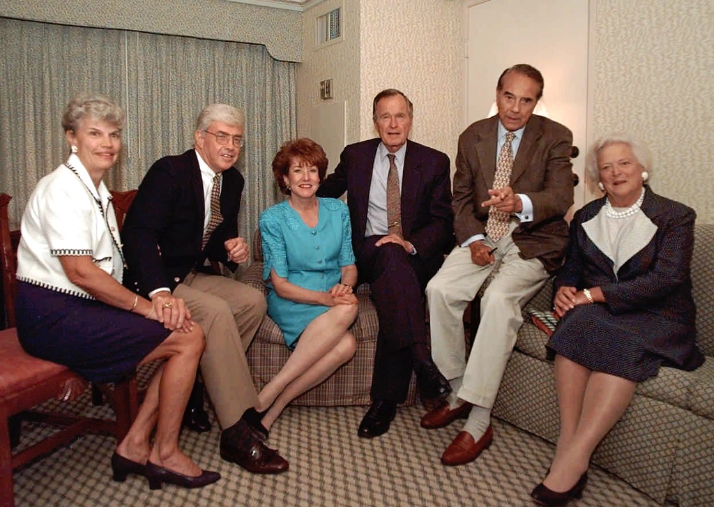. Republican presidential hopeful Bob Dole gestures as he poses for pictures during a photo opportunity with, left to right, Joanne Kemp, Vice presidential hopeful Jack Kemp, Elizabeth Dole, former President George Bush and Barbara Bush, far right in San Diego, Calif., Monday afternoon, Aug. 12, 1996. (AP Photo/Stephan Savoia)