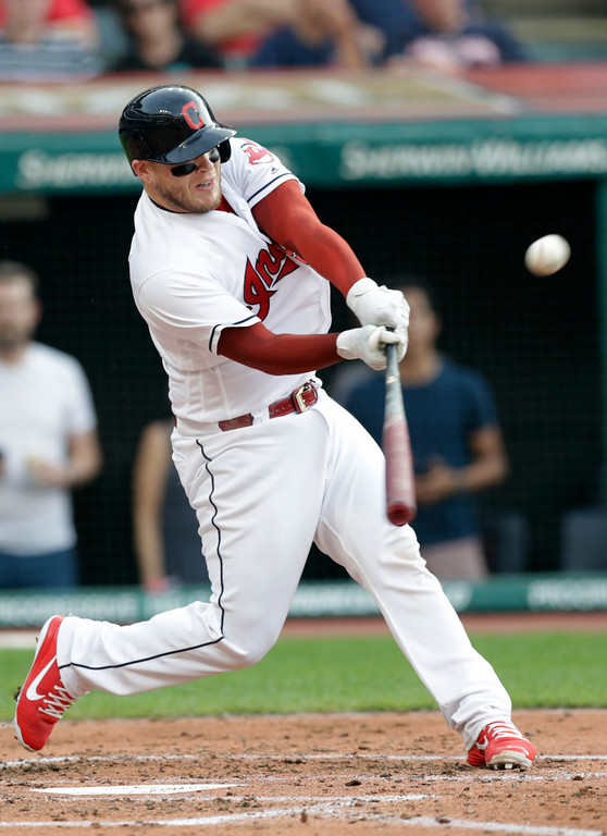 . Cleveland Indians\' Roberto Perez hits a ground rule double off Chicago White Sox starting pitcher Dylan Covey in the second inning of a baseball game, Monday, June 18, 2018, in Cleveland. Lonnie Chisenhall and Rajai Davis scored on the play. (AP Photo/Tony Dejak)