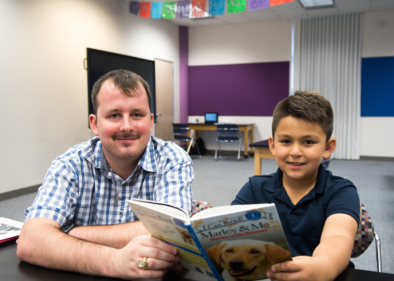 """Hunter Dismuke Reads Red Rocket Readers """"Marley & Me"""" with student Aaron Angel."""