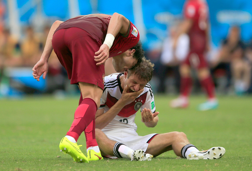 . Portugal\'s Pepe , left, puts his head on Germany\'s Thomas Mueller during the group G World Cup soccer match between Germany and Portugal at the Arena Fonte Nova in Salvador, Brazil, Monday, June 16, 2014.  Pepe was red carded after this.  (AP Photo/Bernat Armangue)