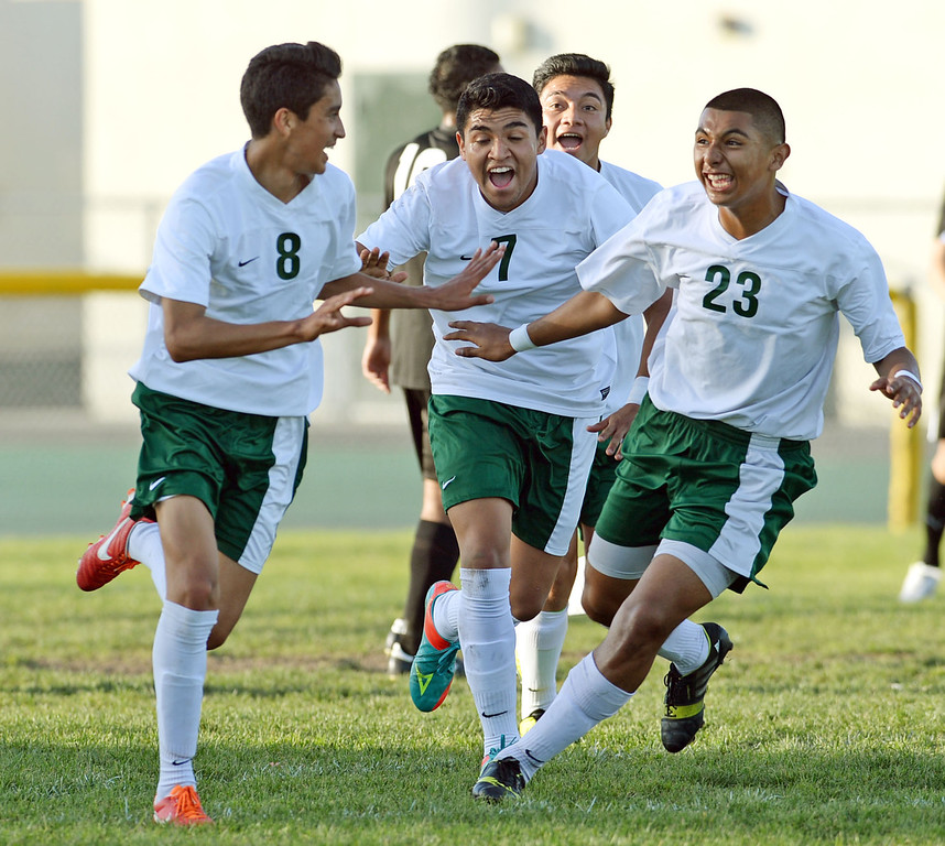 . Narbonne\'s Jaime Enriquez (8) celebrates his goal on San Pedro with teammates Juan Lemus (7) and Andrew Perez (23) in a Marine League boys soccer game Wednesday, February 12, 2014, Harbor City, CA.  Narbonne won 2-0 and seals the league title. Photo by Steve McCrank/Daily Breeze