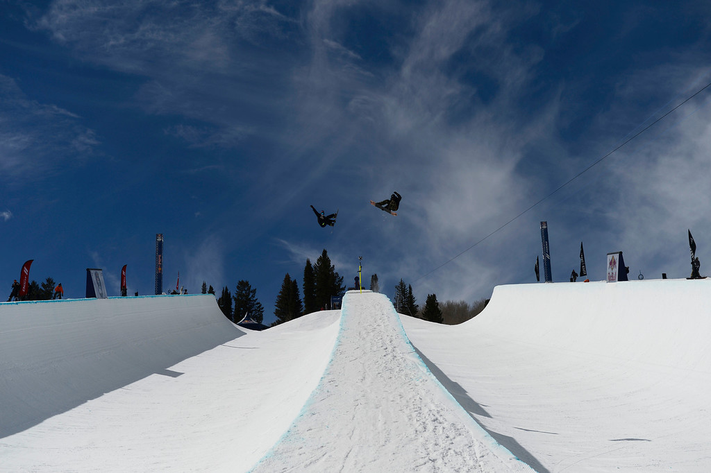 . Professional snowboarders, Louie Vito, left, and Scotty Lago, right, launch off the 4\' spine of the Red Bull double pipe during practice at Buttermilk Mountain Friday morning, March 21, 2014.  (Photo By Andy Cross / The Denver Post)