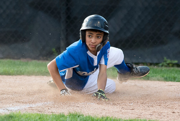 08/29/19 Wesley Bunnell | Staff The McCabe-Waters Astros vs the Forrestville Dodgers 3-0 at Breen Field on in the final game on Thursday night at Breen Field for the City Series championship. Hector Rivera Martinez (8) looks back after sliding safely into home.