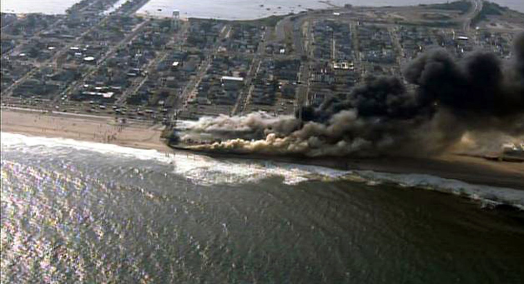 . This frame grab from video provided by Fox 29 shows a raging fire in Seaside Park, N.J. on Thursday, Sept. 12, 2013.  The fire apparently started in an ice cream shop and spread several blocks down  the New Jersey shore boardwalk that was damaged in Superstorm Sandy (AP Photo/Fox 29)
