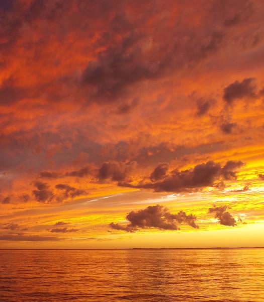 Orange coloured stratocumulus cloudy coastal Sunset Seascape. Australia