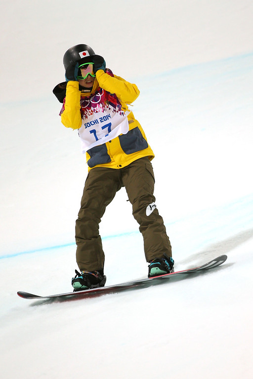 . Rana Okada of Japan reacts in the Snowboard Women\'s Halfpipe Finals on day five of the Sochi 2014 Winter Olympics at Rosa Khutor Extreme Park on February 12, 2014 in Sochi, Russia.  (Photo by Mike Ehrmann/Getty Images)