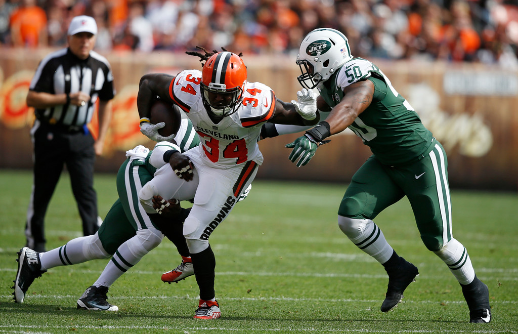 . Cleveland Browns running back Isaiah Crowell tries to get past the New York Jets during the first half of an NFL football game, Sunday, Oct. 8, 2017, in Cleveland. (AP Photo/Ron Schwane)