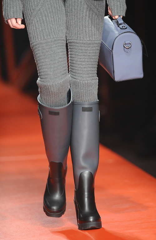 . A model (shoe and bag detail) walks the runway at the Hunter Original show during London Fashion Week Fall/Winter 2015/16 at Rear Block Workshop on February 23, 2015 in London, England.  (Photo by Stuart C. Wilson/Getty Images)