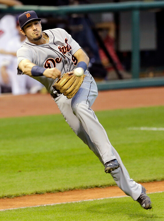 . Detroit Tigers\' Nick Castellanos throws out Cleveland Indians\' Michael Bourn at first base in the third inning of a baseball game, Wednesday, Sept. 3, 2014, in Cleveland. (AP Photo/Tony Dejak)