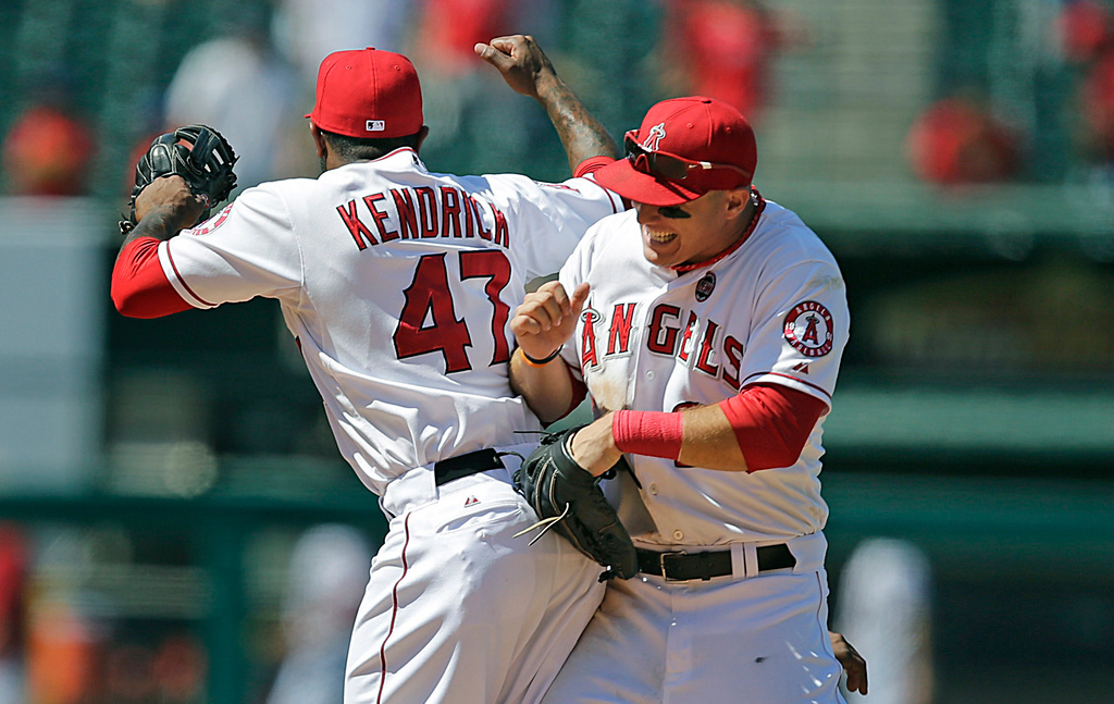 . Los Angeles Angels teammates Howie Kendrick, left, and Mike Trout celebrate their team\'s 1-0 win over the Minnesota Twins in Anaheim, Calif., on Wednesday, July 24, 2013. The Twins managed just two hits in the game.   (AP Photo/Jae C. Hong)