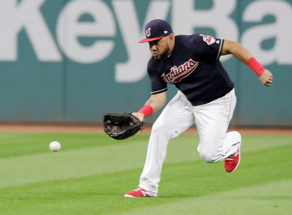 . Cleveland Indians\' Melky Cabrera fields a ball hit by Tampa Bay Rays\' Kevin Kiermaier in the sixth inning of a baseball game, Saturday, Sept. 1, 2018, in Cleveland. Kiermaier hit an RBI single. (AP Photo/Tony Dejak)