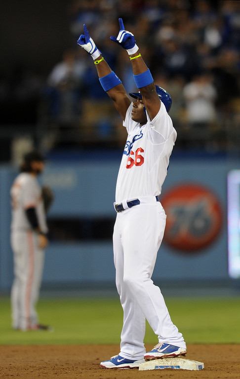 . Dodgers\' Yasiel Puig points after hitting a double and knocking in Dee Gordon to give the Dodgers a 2-1 lead in the seventh-inning, Thursday, September 12, 2013, at Dodger Stadium. (Photo by Michael Owen Baker/L.A. Daily News)
