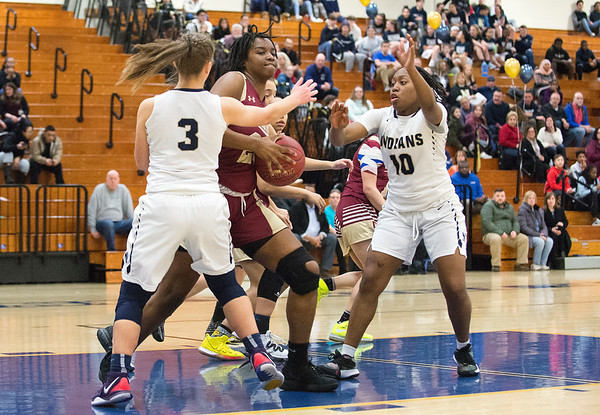 02/13/20 Wesley Bunnell | StaffrrNewington girls basketball defeated New Britain at home Thursday evening. New Britain's Tianna Sweeney (23) guarded by Karissa Zocco (3) and Ashanti Frazier (10).