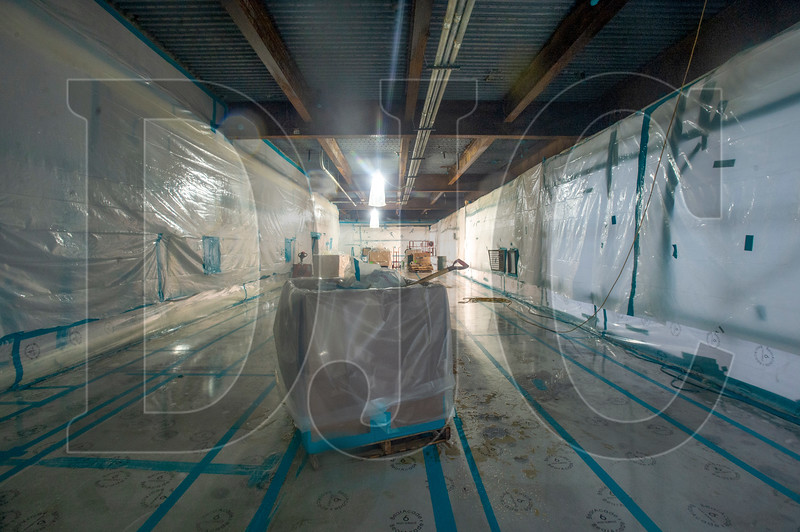A section of the Exchange Building remains sealed off with plastic sheeting to facilitate abatement of asbestos-laden fireproofing material from the building's steel columns and beams. (Josh Kulla/DJC)