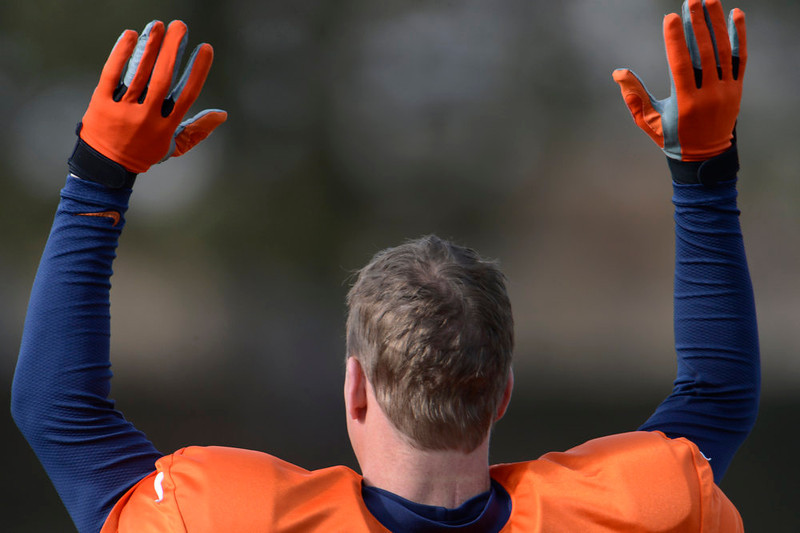 . Denver Broncos quarterback Peyton Manning (18) stretches during practice Wednesday, January 8, 2013 at Dove Valley.  John Leyba, The Denver Post