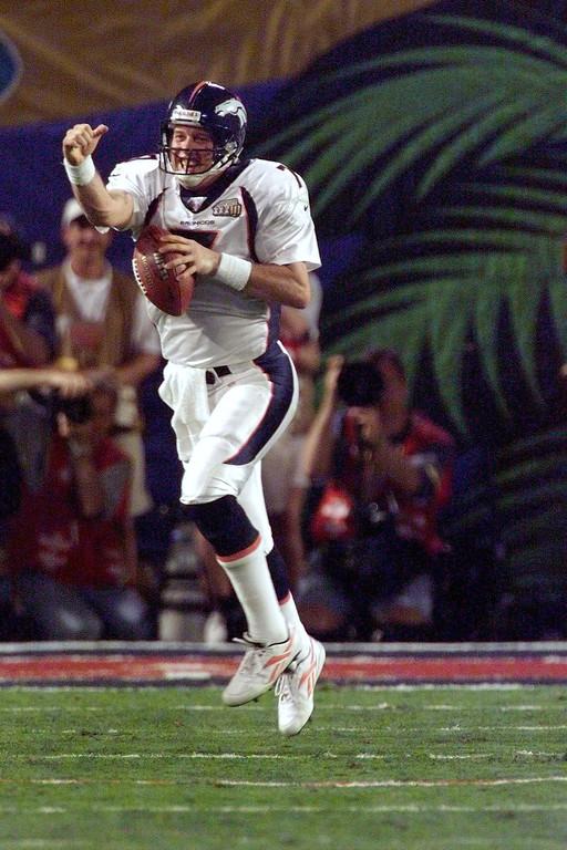 . Denver Broncos John Elway celebrates his 4th quarter touchdown during Super Bowl XXXIII at Pro Player Stadium.  (John Leyba/The Denver Post)