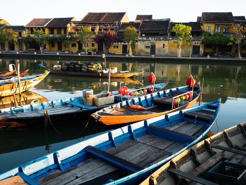 Wooden Boats Anchored with Hoi An Buildings in Background