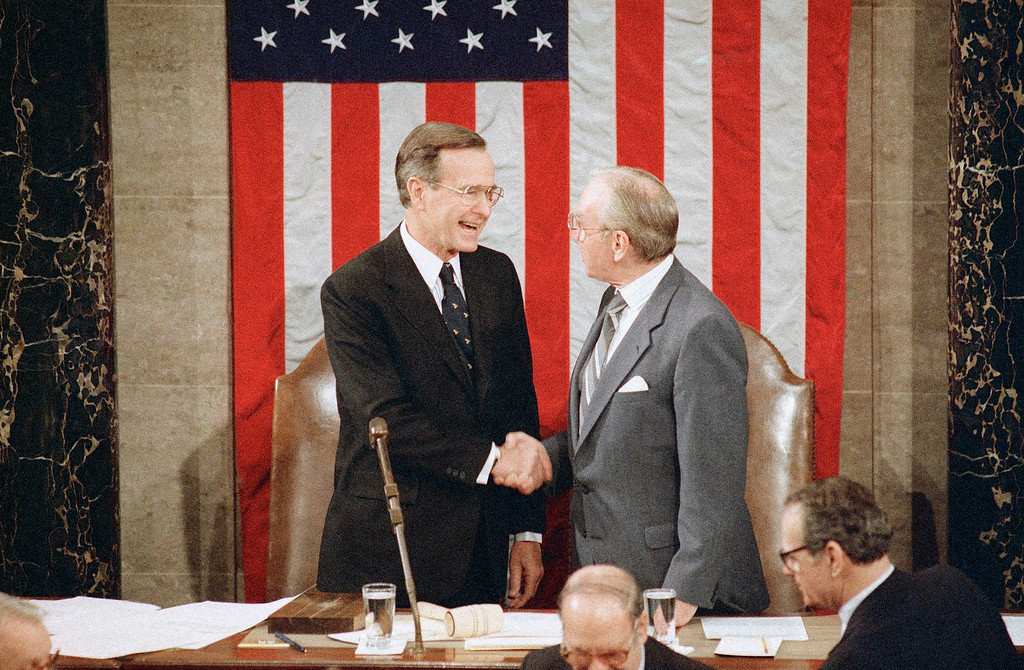 . U.S. President-elect George H. Bush shakes hands with House Speaker Jim Wright of Texas during a joint session of Congress on Capitol Hill in Washington, Wednesday, Jan. 5, 1989. Bush, in his last official duty as presiding officer of the Senate, ruled over the session convened to count electoral votes and formally announced his own presidential victory. Martin Van Buren was the last sitting Vice President to do the same some 152 years ago. (AP Photo/Rick Bowmer)