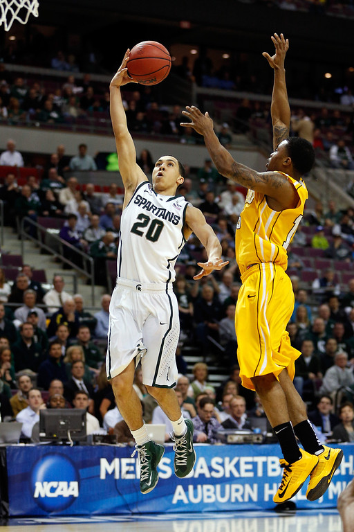 . Travis Trice #20 of the Michigan State Spartans drives for a shot attempt in the first half against Erik Buggs #15 of the Valparaiso Crusaders during the second round of the 2013 NCAA Men\'s Basketball Tournament at at The Palace of Auburn Hills on March 21, 2013 in Auburn Hills, Michigan.  (Photo by Gregory Shamus/Getty Images)