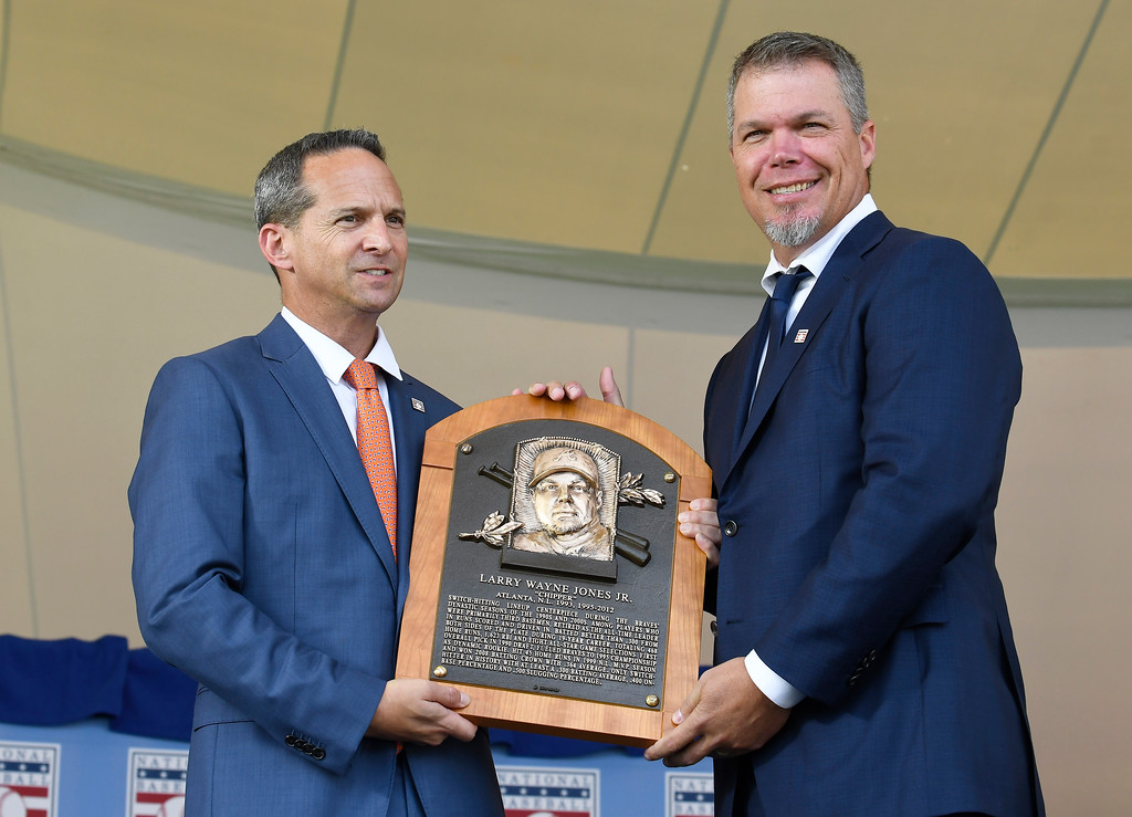 . Hall of Fame President Jeff Idelson, left, poses with National Baseball Hall of Fame inductee Chipper Jones during an induction ceremony at the Clark Sports Center on Sunday, July 29, 2018, in Cooperstown, N.Y. (AP Photo/Hans Pennink)