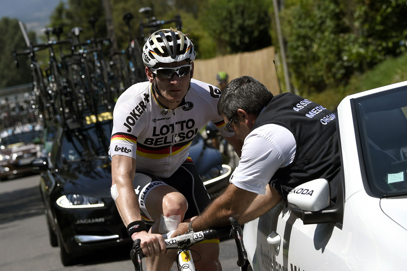 . Germany\'s Andre Greipel receives medical assistance during the 197.5 km thirteenth stage of the 101st edition of the Tour de France cycling race on July 18, 2014 between Saint-Etienne and Chamrousse, central eastern France.  (ERIC FEFERBERG/AFP/Getty Images)