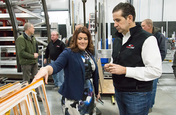 02/15/19 Wesley Bunnell | Staff Mayor Erin Stewart and Sign Pro President Peter Rappoccio look over scrap colored plexiglass which were used to build trim pieces for the outside of the Beehive Bridge project in New Britain. Stewart visited the manufacturer, Sign Pro, along with other city employees on Friday for a project update.