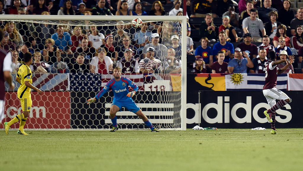 . A ball deflected by a Columbus Crew player sails past goaltender Steve Clark #1 of the Columbus Crew as Deshorn Brown #26 of the Colorado Rapids looks on during the second half of an MLS game at Dick\'s Sporting Goods Park on July 4, 2014, in Commerce City, Colorado. The goal was credited as an own-goal by the Crew. (Photo by Daniel Petty/The Denver Post)