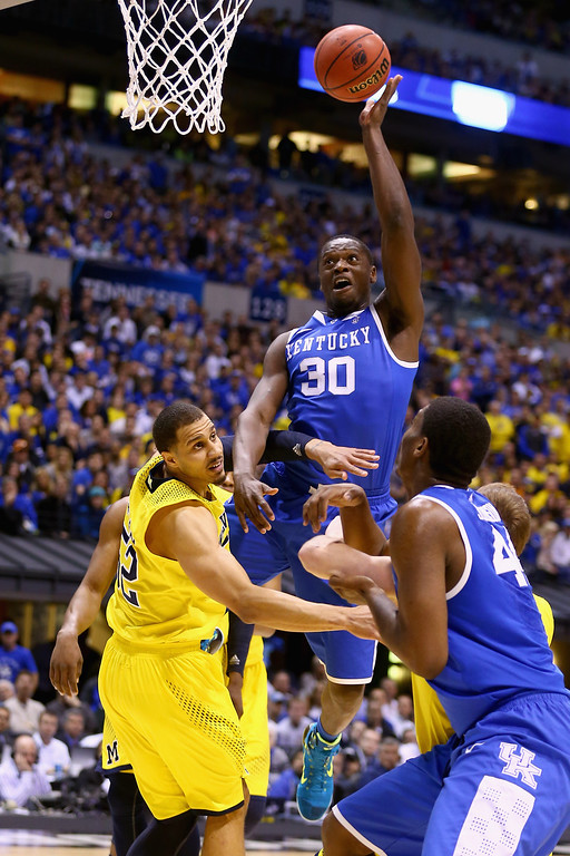 . Julius Randle #30 of the Kentucky Wildcats shoots the ball over Jordan Morgan #52 of the Michigan Wolverines in the first half during the midwest regional final of the 2014 NCAA Men\'s Basketball Tournament at Lucas Oil Stadium on March 30, 2014 in Indianapolis, Indiana.  (Photo by Andy Lyons/Getty Images)