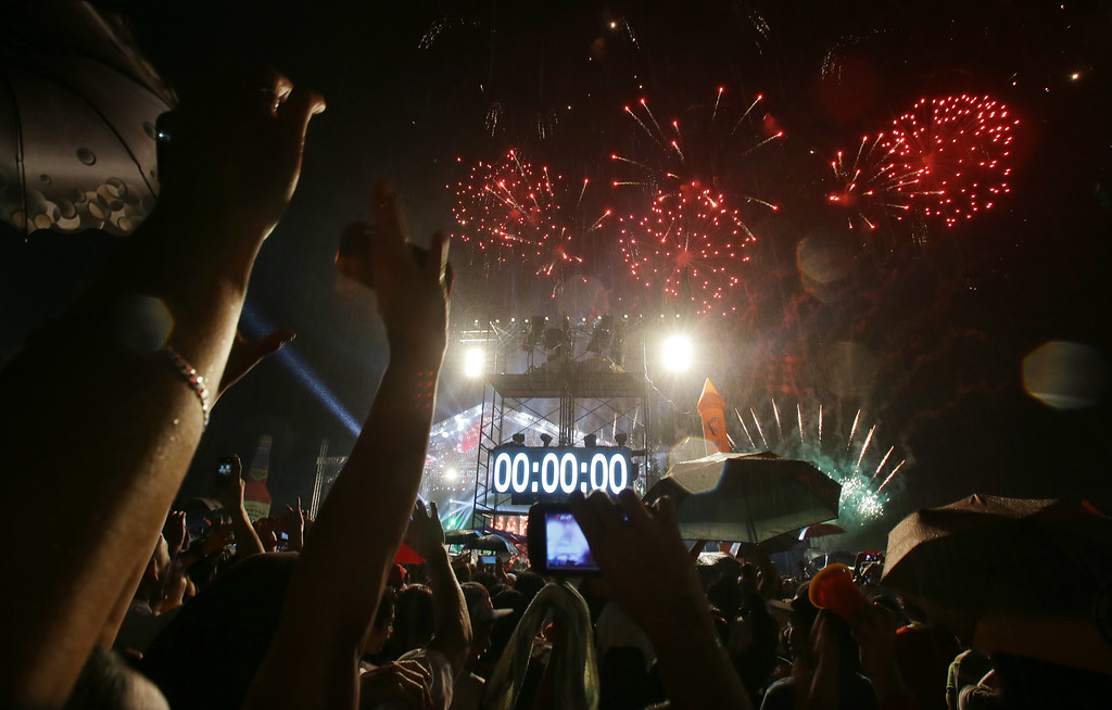 . Crowds cheer as the countdown hits zero and fireworks begin during a New Year\'s Day celebration at the Quezon Memorial Circle in suburban Quezon city, north of Manila, Philippines on Thursday, Jan. 1, 2015. (AP Photo/Aaron Favila)