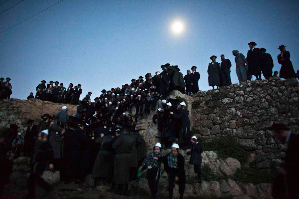 """. Ultra-Orthodox Jews take part in the \""""Mayim Shelanu\"""" ceremony to collect water from a natural spring, near Jerusalem March 24, 2013. The water is used to make matza, the traditional unleavened bread to be eaten on the Jewish holiday of Passover which starts on Monday. Passover commemorates the flight of Jews from ancient Egypt, as described in the Exodus chapter of the Bible.  REUTERS/ Nir Elias"""