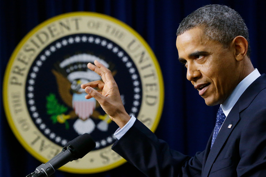""". President Barack Obama gestures as he speaks about the fiscal cliff, Monday, Dec. 31, 2012, in the South Court Auditorium at the White House in Washington. The president said it appears that an agreement to avoid the fiscal cliff is \""""in sight,\"""" but says it\'s not yet complete and work continues.  (AP Photo/Charles Dharapak)"""