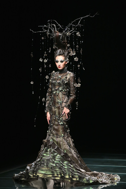 . A model showcases designs on the runway at MGPIN 2015 Mao Geping Makeup Trends Launch show during Mercedes-Benz China Fashion Week Spring/Summer 2015 at Beijing Hotel on October 27, 2014 in Beijing, China.  (Photo by Feng Li/Getty Images)
