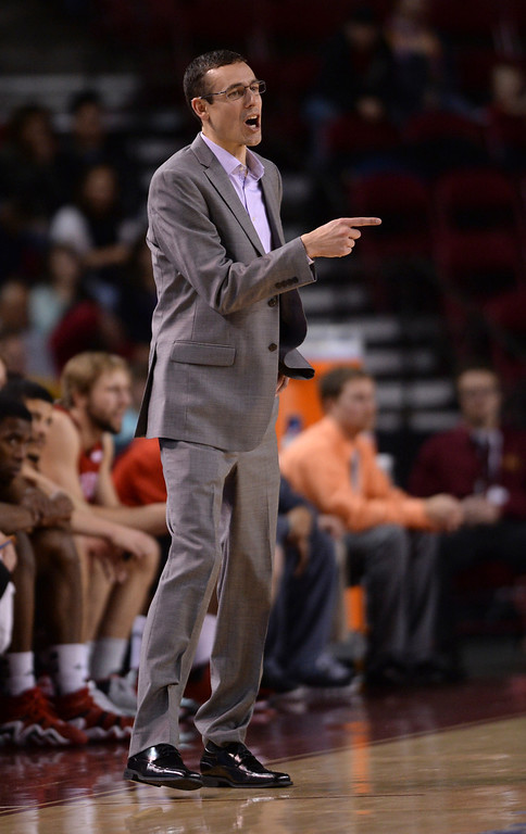 . DENVER, CO. - FEBRUARY 8, 2014: South Dakota coach Joey Jones got his point across from the bench in the second half. The University of Denver defeated South Dakota 75-67 Saturday evening, February 8, 2014. Photo By Karl Gehring/The Denver Post