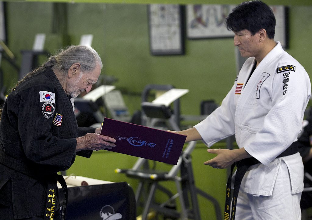 """. <p><b> Country music legend Willie Nelson made news last week when he earned a fifth-degree black belt in this ancient martial art � </b> <p> A. Gong Kwon Yu Sul <p> B. Karate <p> C. Take Weed Doh <p><b><a href=\'http://www.telegraph.co.uk/culture/music/worldfolkandjazz/10794872/Willie-Nelson-gets-5th-degree-black-belt-at-81.html\' target=\""""_blank\""""> LINK </a></b> <p>    (AP Photo/Austin American-Statesman, Ralph Barrera)"""