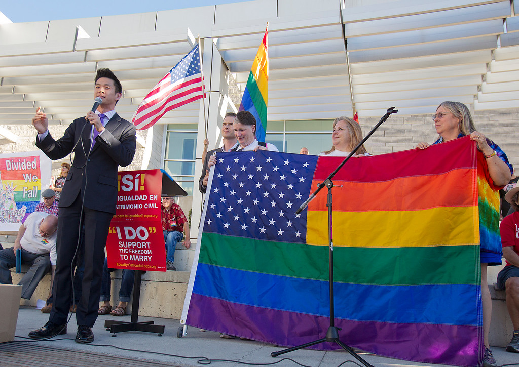 . At left, Evan Low, Mayor of Campbell speaks at a San Jose City Hall rally to celebrate the U.S. Supreme Court decision on DOMA and Proposition 8, in San Jose, Calif. on Wednesday, June 26, 2013.  (LiPo Ching/Bay Area News Group)