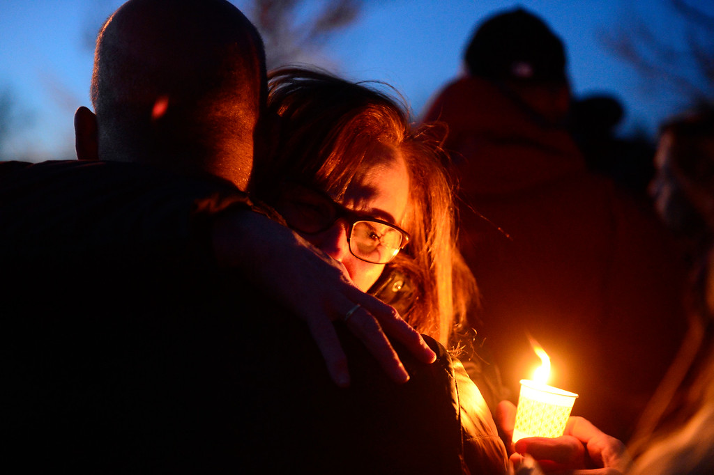 . A family member of Dr. Kenneth Atkinson hugs a well wisher after a vigil for Dr. Kenneth Atkinson on April 5, 2016 in Centennial, Colorado. Close to 400 people showed up to pay their respects to Dr. Atkinson, who lost his life trying to protect a woman whose husband shot her. (Photo by Brent Lewis/The Denver Post)