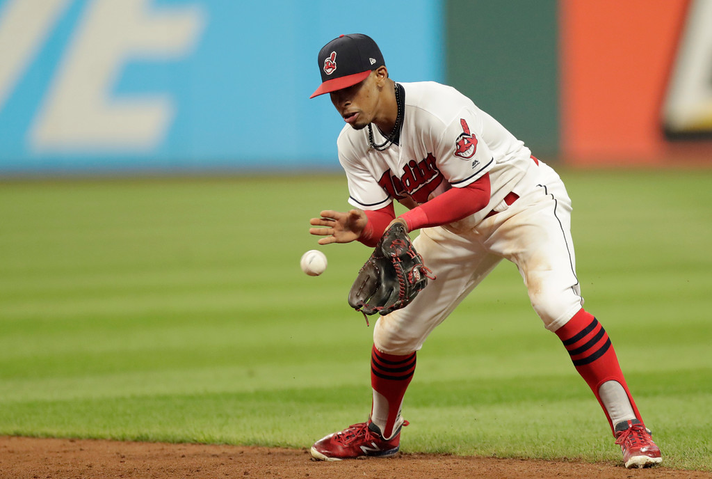 . Cleveland Indians\' Francisco Lindor fields a ball hit by Minnesota Twins\' Eddie Rosario in the sixth inning of a baseball game, Monday, Aug. 6, 2018, in Cleveland. Rosario was out on the play. (AP Photo/Tony Dejak)